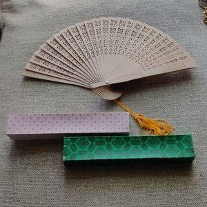 Pierced wooden oriental fan
